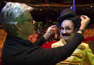 Roger J. Stricker, left, makes adjustments to Young Ringmaster (Jimmy Slonina) during a preview of the fifth annual one-night-only One Night for One Drop benefit show at the Zumanity Theater at New York-New York Tuesday, Feb. 7, 2017. The show is scheduled for March 3, 2017. One Drop is an international Non-profit organization. .