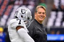 In this Saturday, Jan. 7, 2017, file photo, Oakland Raiders coach Jack Del Rio walks on the field before the first half of an AFC ...