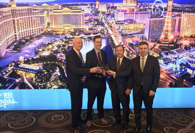 From left, Clark County Commissioner Larry Brown, Aviation Department CMO Chris Jones, LVCVA President/CEO Rossi Ralenkotter and Routes Americas Brand Director Steven Small mark the opening of the Routes America travel conference at Aria on Feb. 15, 2017.