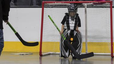 Fan Gavyn Trudel, 7, stops a ball between his knees while playing goalie on the arena floor within the T-Mobile Arena for hockey-related games as the Golden Knights hockey team holds a 24-hour open house on Tuesday, February 21, 2017.