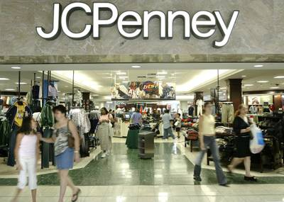 In this Aug. 16, 2005 file photo, customers walk out of a J.C. Penney department store in Dallas.