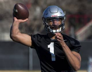UNLV QB Armani Rogers looks to his receiver during UNLV's first spring practice of the year on Wednesday, March 1, 2017.