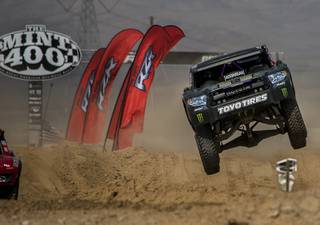 Seven time national off-road racing Champion Ballistic BJ Baldwin flies through the air during the unlimited start of the 2017 Mint 400 about Jean and Primm, Nevada, with hundreds of vehicles in limited and unlimited race on Saturday, March 4, 2017.