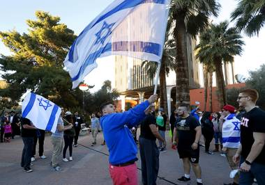 UNLV student William Moeller waves an Israeli flag at Valerie Pida Plaza before a rally at UNLV Monday, March 6, 2017. About 200 students and supporters marched and rallied to protest recent acts of anti-Semitism in Las Vegas and across the United States.