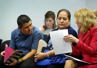 Luis and Olivia Espinoza confer with Marianne Lanuti, right, an attorney specializing in special education, as they wait for a Nevada Senate Committee on Education video conference at the Sawyer State Building Tuesday, March 7, 2017.