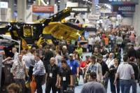 Attendees check out the exhibits in the South Hall during the first day of the 2017 CONEXPO-CON/AGG convention Tuesday, March 7, 2017, at the Las Vegas Convention Center.