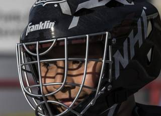 A student from After School All-Stars tries his hand as a goalie while the Vegas Golden Knights host a Youth Hockey Clinic at AutoNation Toyota on Tuesday, March 7, 2017.