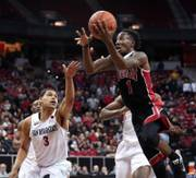 San Diego State guard Trey Kell (3) is late on the defense as UNLV guard Kris Clyburn (1) moves in for a lay up during the Mountain West Basketball Tournament at the Thomas & Mack Center on Wednesday, March 8, 2017.