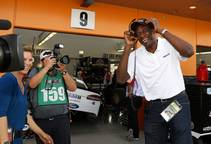 NBA Hall of Famer Dikembe Mutombo, right, laughs in an interview outside the Kevin Harvick's garage during qualifying for the Monster Energy NASCAR Cup Series ...