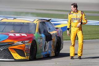 Kyle Busch walks away from his car in the pit area at the end of the Kobalt 400, a NASCAR Monster Energy Cup Series race, at the Las Vegas Motor Speedway Sunday, March 12, 2017. Busch got into an accident with Joey Logano as they raced for third place, sending Busch spinning down pit road.