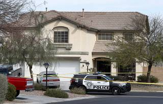 A Metro Police vehicle is shown in front of a house after a fatal shooting in the Northwest valley Wednesday, March 15, 2017.