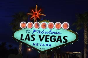"The ""Welcome to Fabulous Las Vegas"" sign is turned green ..."