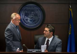 Executive Director Bob Bennett  chats with Chairman Anthony Marnell III as the Nevada State Athletic Commission convenes as will hear the UFC fighter Conor McGregor hearing at the Grant Sawyer Building to settle his fine for an incident more than a year ago Wednesday, March 22, 2017.