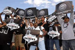Laborers Union members, Local 872, cheer for a television camera by the Welcome to Las Vegas sign after NFL owners in Phoenix voted to approve a Raiders move to Las Vegas Monday, March 27, 2017.