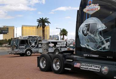 Trucks decorated by the Laborers Union, Local 872, are parked in the median of Las vegas Boulevard South near the Welcome to Las Vegas sign as NFL owners in Phoenix voted to approve a Raiders move to Las Vegas Monday, March 27, 2017.