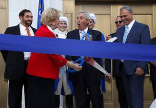 Las Vegas Mayor Carolyn Goodman and Justice James Hardesty prepare to cut a ribbon during a grand opening ceremony for the Nevada Supreme Court and Nevada Court of Appeals courthouse in downtown Las Vegas Monday, March 27, 2017. Also pictured are Chief Justice Michael Cherry, left, and builder Yohan Lowie, right, CEO of EHB Companies.