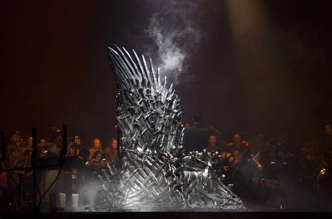 The Iron Throne makes an appearances during the intro of the Games of Thrones Live Concert Experience at MGM Grand Garden Arena in Las Vegas, Saturday, March 25, 2017.