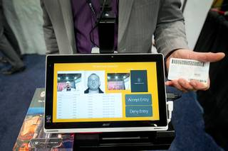 Trevor Thomas of PatronScan demonstrates an ID scanning kiosk during the Nightclub & Bar Convention and Trade Show at the Las Vegas Convention Center Tuesday, March 28, 2017. The system can spot fake IDs, alert to double scans, and identify banned patrons.