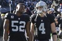 Raiders defensive end Khalil Mack (52) and quarterback Derek Carr (4) before a game against the Colts in Oakland, Calif., Saturday, Dec. 24, 2016.