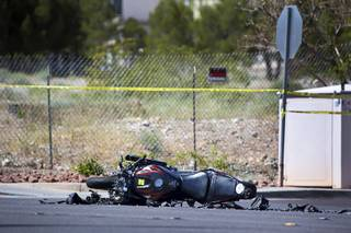 A motorcycle is shown on West Flamingo Road near Durango Drive after an accident Wednesday, March 29, 2017.