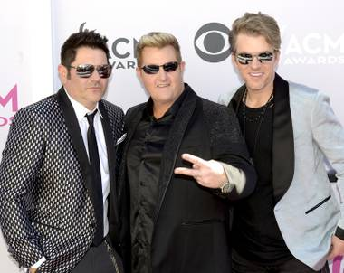 (left to right) Jay DeMarcus, Gary LeVox and Joe Don Rooney, also known as Rascal Flatts and nominee for Vocal Group of the Year walk the Academy of Country Music Awards red carpet at T-Mobile Arena. Sunday, April 2, 2017.