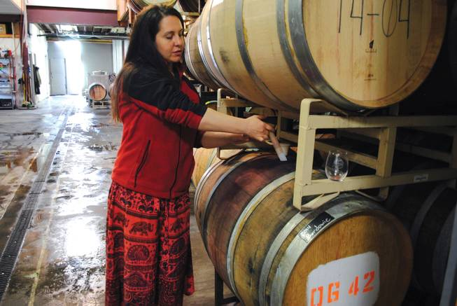 Guide Dina Ribaudo pulls 2014 Bordowie from a barrel for a tour group at Page Springs Cellars in Cornville, Ariz.