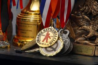Kettlebell medals and trophies like a shelf at Kettlebell Sanctuary, 6520 S. Buffalo Dr., Wednesday, April 12, 2017.