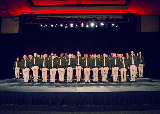 Las Vegas Metro Police recruits arrive onstage for a graduation ceremony at Red Rock Resort Thursday April 13, 2017.  Seventy recruits graduated the academy.