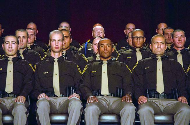 Las Vegas Metro Police recruits listen to speakers during a graduation ceremony at Red Rock Resort Thursday April 13, 2017.  Seventy recruits graduated the academy.