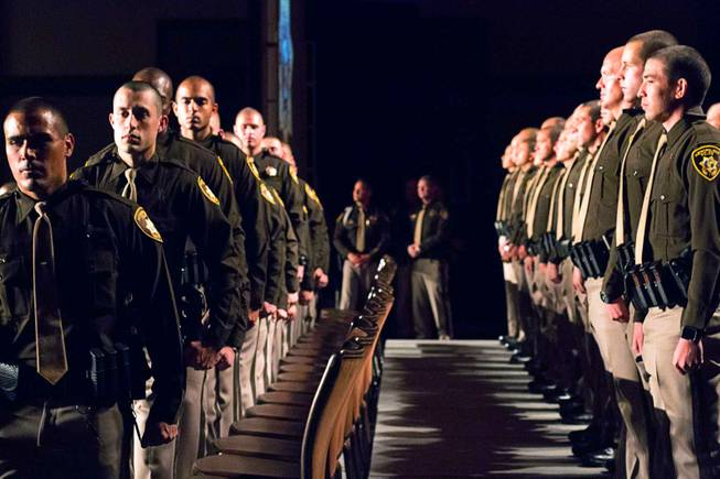 Las Vegas Metro Police recruits stand during a graduation ceremony at Red Rock Resort Thursday April 13, 2017.  Seventy recruits graduated the academy.