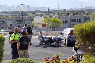 Henderson Police investigate an accident between Henderson Police motorcycle officer and a Honda Fit on Green Valley Parkway at Ramrod Avenue Tuesday, April 18, 2017.