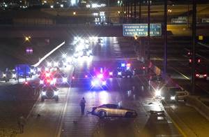 The westbound lanes of I-215 are shut down after an accident involving an unmarked Henderson Police vehicle near Valle Verde Drive in Henderson Thursday, April 20, 2017.