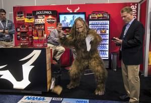 Sasquatch tears up some cardboard about the Jack Link's display during the National Automatic Merchandising Association Show within the Venetian Convention Center on Thursday, April 20, 2017.