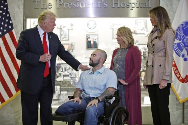 Trump awards Purple Heart to wounded Army sergeant