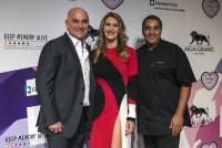 Andre Agassi and wife Stefanie Graf pose with celebrity Chef Michael Mina on the red carpet for Keep Memory Alive's 21st annual Power of Love Gala inside the MGM Grand Garden Arena in support of the Cleveland Clinic Lou Ruvo Center for Brain Health on Thursday, April 27, 2017.