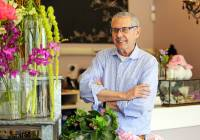 Rick McVey, owner of Dilly Lily, poses for a photo at his shop Wednesday, April 26, 2017, in Chicago. If the Trump administration's plan to lower tax rates becomes law, it will likely benefit McVey. The florist has a range of possibilities, not just from the prospect of lower taxes, but that he'd get more business from customers who have more money to spend.