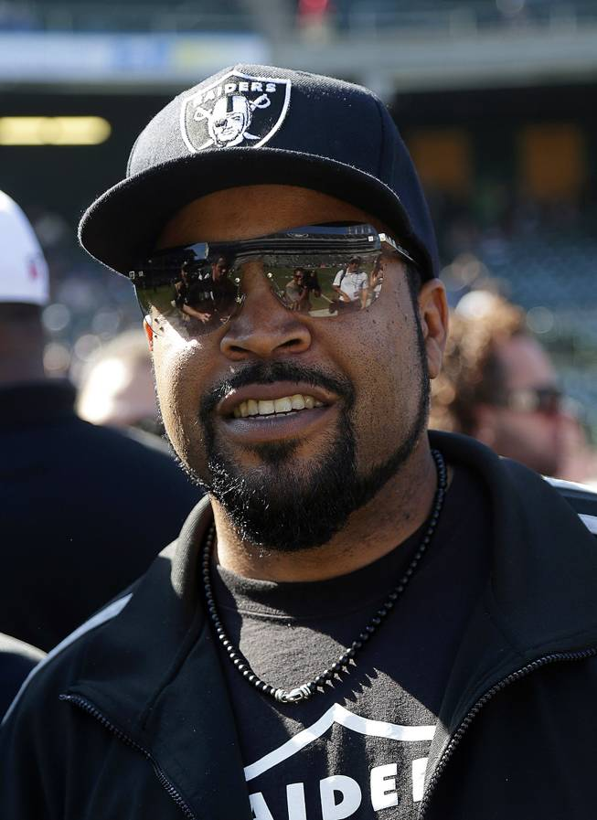 Rapper Ice Cube smiles before an NFL football game between the Oakland Raiders and the Arizona Cardinals in Oakland, Calif., Sunday, Oct. 19, 2014.