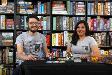Albert Smedley and April Pena play King of Tokyo in their garage Sunday May 7, 2017.