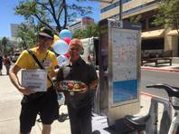 Kelly Fairchild (left) receives a surprise of balloons, a gift card and cupcakes from RTC Bicycle and Outreach Coordinator Ron Floth for being the bike share's 10,000th rider since it launched last fall in downtown Las Vegas.