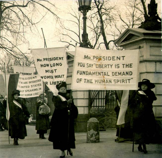 Members of the National Woman's Party demonstrate at the White House in 1918, demanding voting rights. Suffrage was granted nationwide in 1920.
