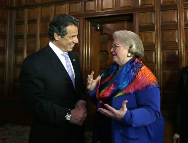 New York Gov. Andrew Cuomo talks with Weddington after a news conference at the Capitol on June 4, 2013, in Albany.