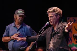 Journey keyboardist Jonathan Cain and bass guitarist Ross Valory speak with music students at the Las Vegas Academy of the Arts on May 17, 2017.