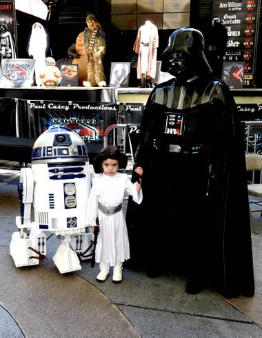 R2-D2, Princess Leia and her Father Darth Vader pose during the Las Vegas Car Stars meet and greet autograph session at Fremont Street Experience . Saturday, May 20, 2017.
