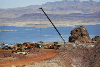 In this May 19, 2017, photo, construction continues on the Southern Nevada portion of U.S. Interstate 11 overlooking Lake Mead near Boulder City, Nev. The planned route for U.S. Interstate 11 will connect Las Vegas with Phoenix.