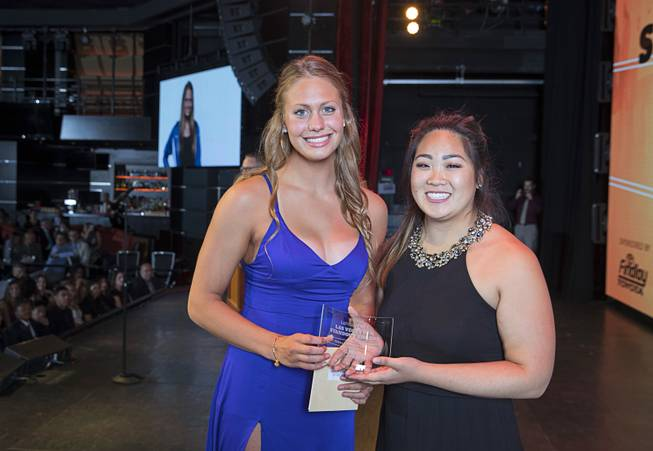 Swimmer Abby Richter, left, accepts the award for 2017 Female Athlete of the Year from Kaitlyn Matsubara of Findlay Toyota during the second annual Las Vegas Sun Standout Awards, an award show recognizing local high school athletes, at the South Point Wednesday, May 24, 2017. Findlay is one of the sponsors of the event.