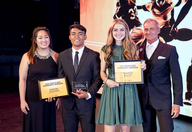 2017 Scholar Athletes Darion Acohido of Liberty High School and Kenadee Bailey of Boulder City High School pose with Kaitlyn Matsubara of Findlay Toyota and Greenspun Media Group's Gordon Prouty during the second annual Las Vegas Sun Standout Awards, an award show recognizing local high school athletes, at the South Point Wednesday, May 24, 2017.