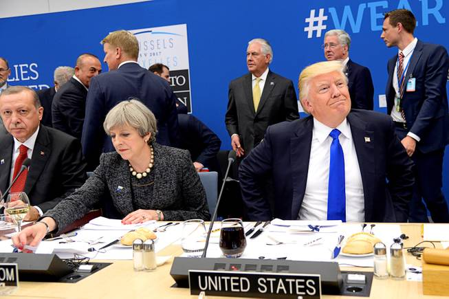 Trump appears to shove prime minister at North Atlantic Treaty Organisation summit