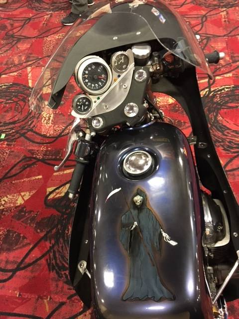 Custom artwork adorns the fuel tank of a 1971 Honda CB 750 cafe racer at the Mecum Las Vegas Motorcycle Auction. The bike is among more than 600 that go up for sale beginning Friday, June 2, 2017, at South Point Exhibit Hall.