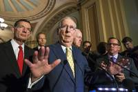 "Senate Majority Leader Mitch McConnell, R-Ky., joined by, from left, Sen. John Barrasso, R-Wyo., Sen. John Thune, R-S.D., and Majority Whip John Cornyn, R-Texas, speaks following a closed-door strategy session, at the Capitol in Washington, Tuesday, June 20, 2017. Sen. McConnell says Republicans will have a ""discussion draft"" of a GOP-only bill scuttling former President Barack Obama's health care law by Thursday."