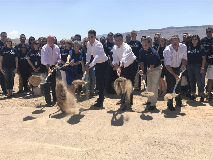 Local, state and company officials, including Gov. Brian Sandoval, third from right, mark the start of construction of Aristocrat Technologies' new headquarters on Hualapai Way and the 215 Beltway on June 23, 2017.